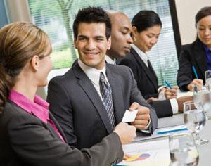 Businessman at Meeting Smiling